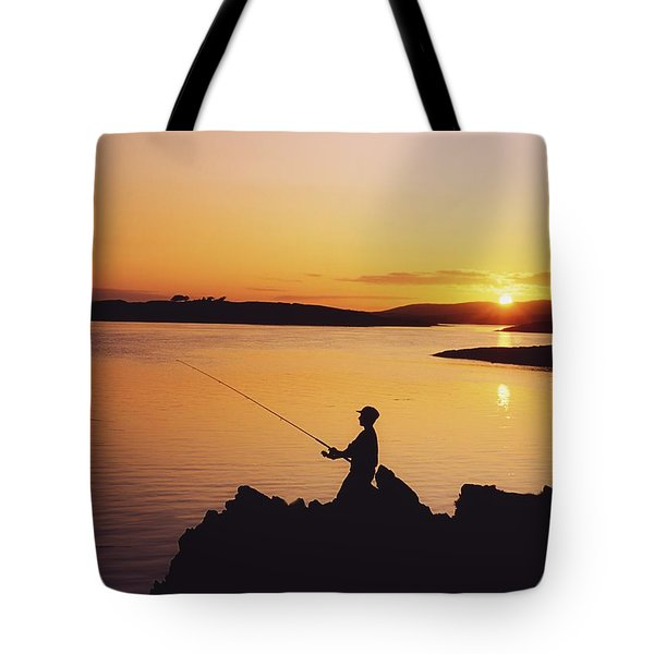 Fishing At Sunset, Roaring Water Bay Tote Bag by The Irish Image Collection