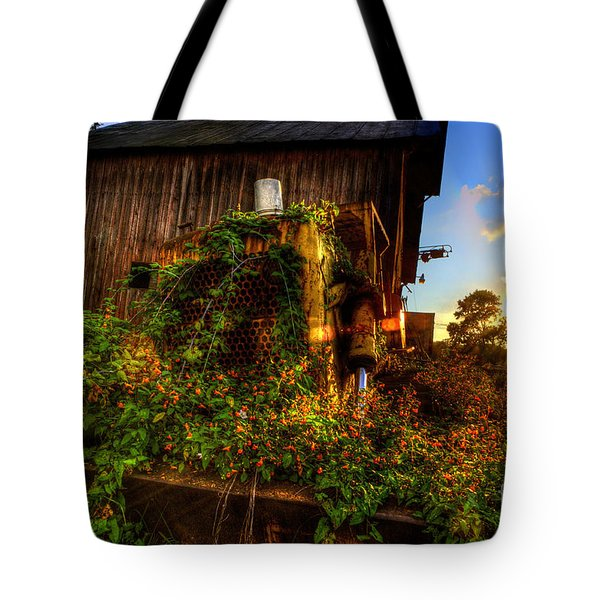 Flowers On Old Bulldozer Sunset Tote Bag by Dan Friend