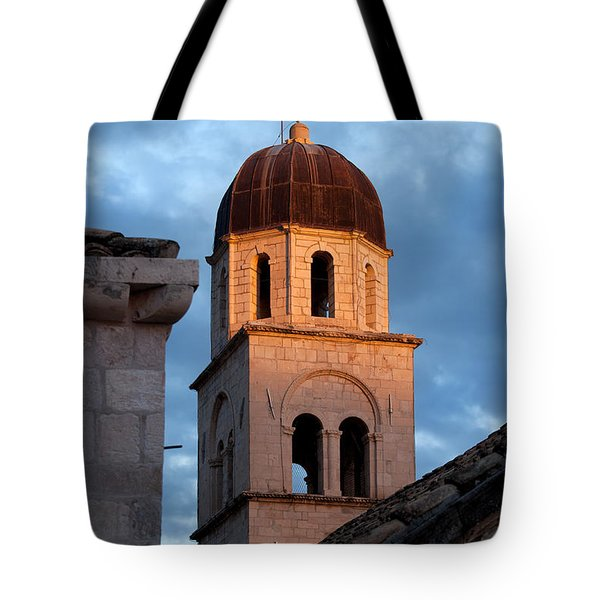 Franciscan Monastery Tower At Sunset Tote Bag by Artur Bogacki