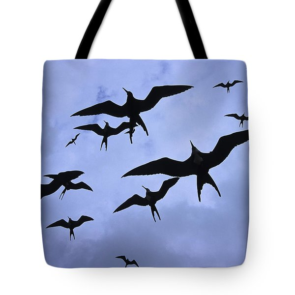 Frigate Birds In Flight. Lighthouse Tote Bag by Ron Watts