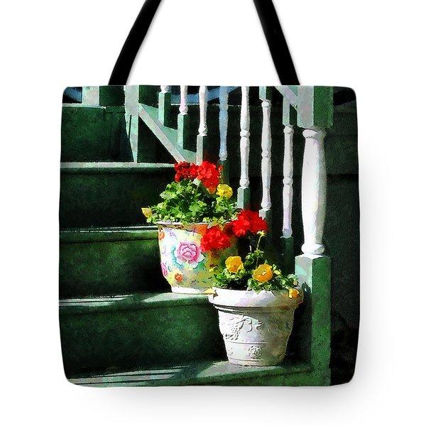 Geraniums and Pansies on Steps Tote Bag by Susan Savad