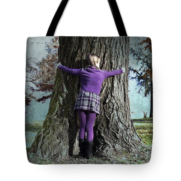 Girl Hugging Tree Trunk Tote Bag by Joana Kruse