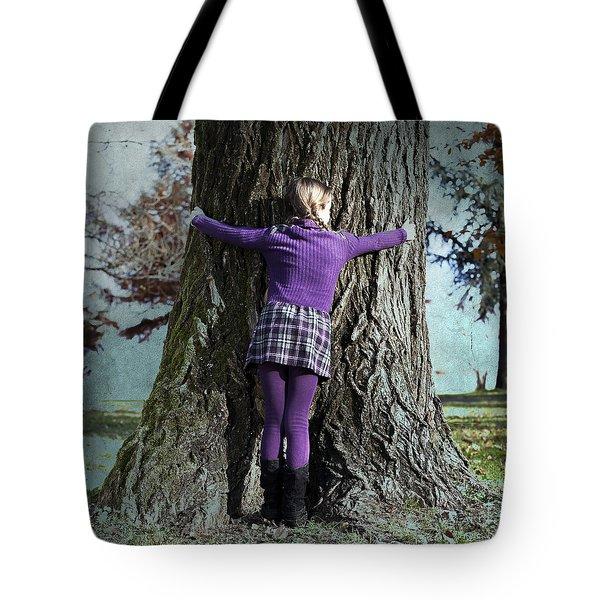 girl hugging tree trunk Tote Bag by Joana Kruse