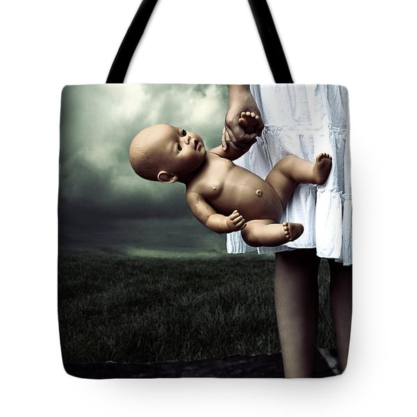 girl with a baby doll Tote Bag by Joana Kruse