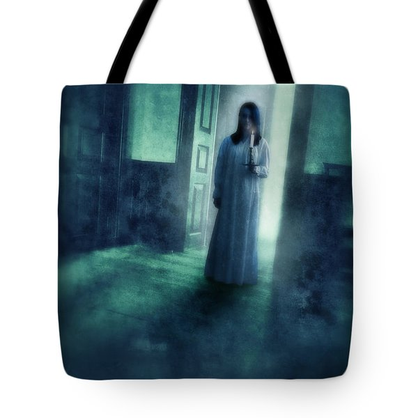 Girl With Candle In Doorway Tote Bag by Jill Battaglia