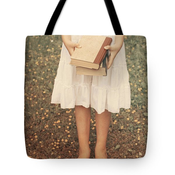 Girl With Old Books Tote Bag by Joana Kruse