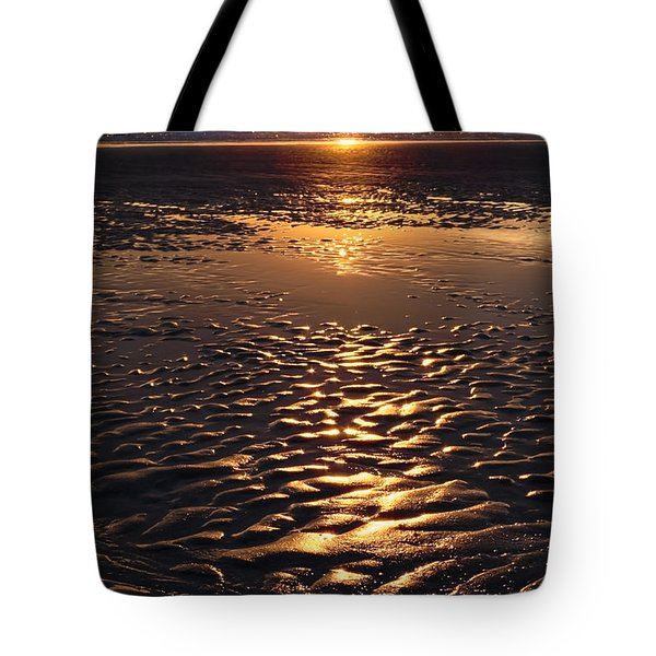 golden sunset on the sand beach Tote Bag by Setsiri Silapasuwanchai