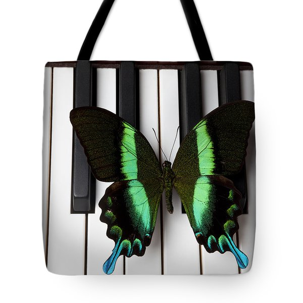 Green And Black Butterfly On Piano Keys Tote Bag by Garry Gay