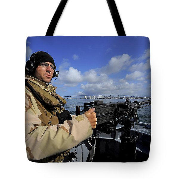 Gunners Mate Mans An M2 Hb .50-caliber Tote Bag by Stocktrek Images
