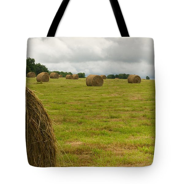Haybales In Field On Stormy Day Tote Bag by Douglas Barnett