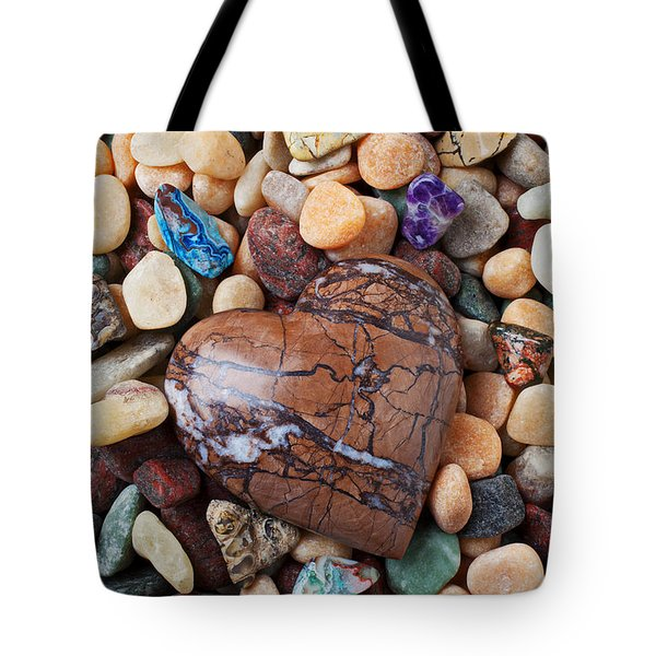 Heart stone among river stones Tote Bag by Garry Gay