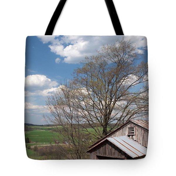 Hillside Weathered Barn Dramatic Spring Sky Tote Bag by John Stephens