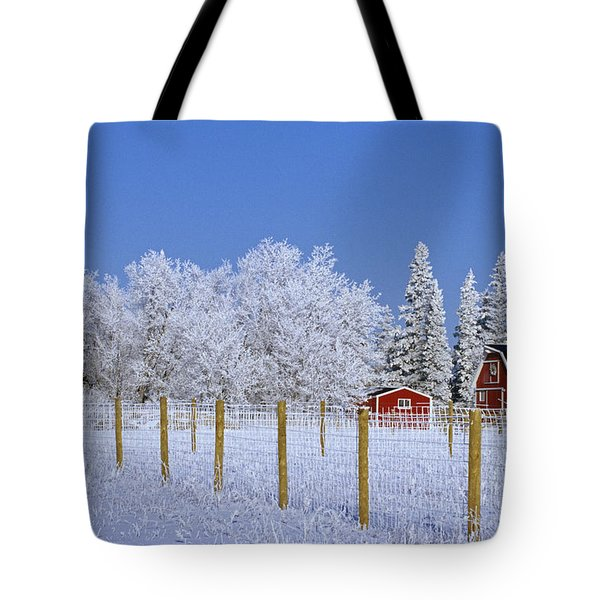 Hoarfrost On Trees Around Red Barns Tote Bag by Mike Grandmailson