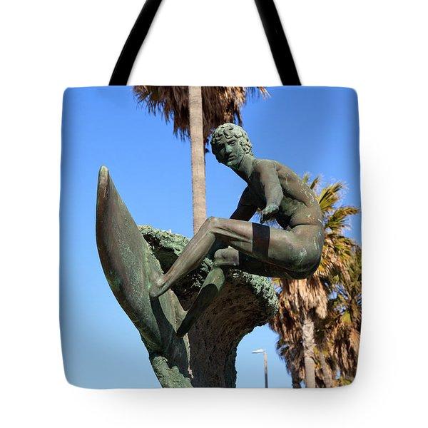 Huntington Beach Surfer Statue Tote Bag by Paul Velgos
