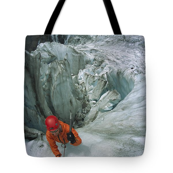 Ice Climber On Steep Ice In Fox Glacier Tote Bag by Colin Monteath