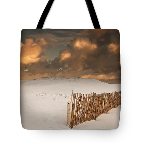 Illuminated Clouds Glowing Over A Snow Tote Bag by John Short