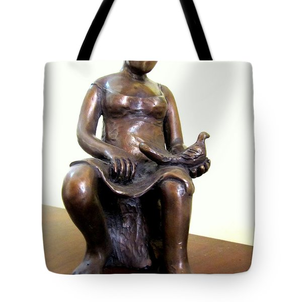 Lady Bird Bronze Sculpture Of A Woman Sitting Holding A Bird With A Dress Face Blurred Strong Legs Tote Bag by Rachel Hershkovitz