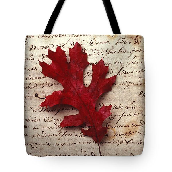Leaf on letter Tote Bag by Garry Gay