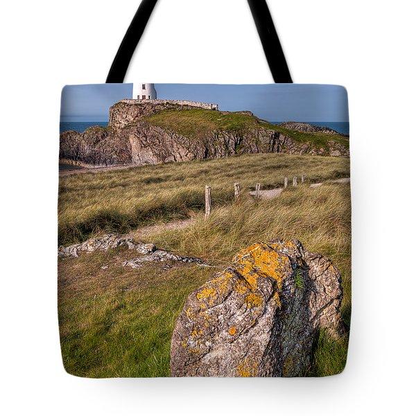 Llanddwyn Rock Tote Bag by Adrian Evans