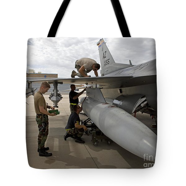 Maintenance Crew Works On Replacing Tote Bag by HIGH-G Productions