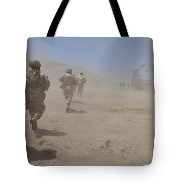 Marines Move Through A Dust Cloud Tote Bag by Stocktrek Images