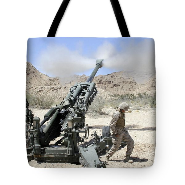 Marines Shoot 100-pound Rounds Tote Bag by Stocktrek Images