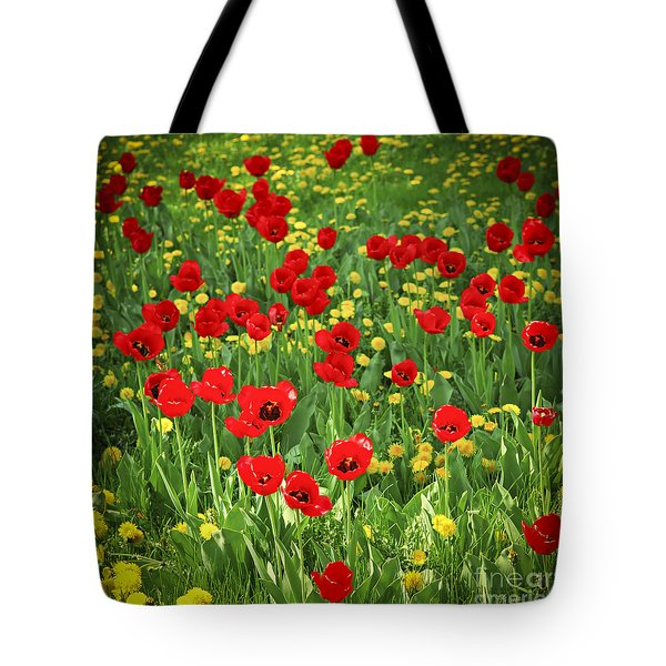 Meadow with tulips Tote Bag by Elena Elisseeva