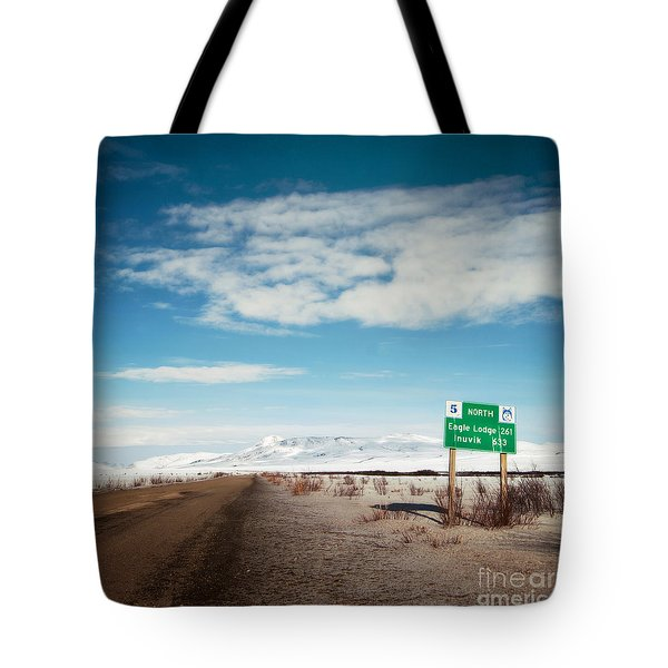 Milepost at the Dempster Highway Tote Bag by Priska Wettstein