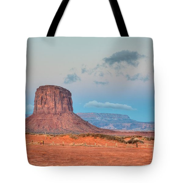 Mitchell Butte in Monument Valley Tote Bag by Clarence Holmes