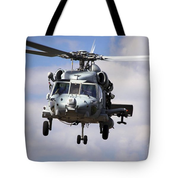 Navy Pilots In A Sh-60f Seahawk Conduct Tote Bag by Michael Wood