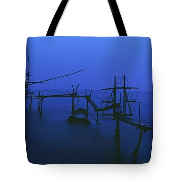 Old Fishing Platform Over Water At Dusk Tote Bag by Axiom Photographic