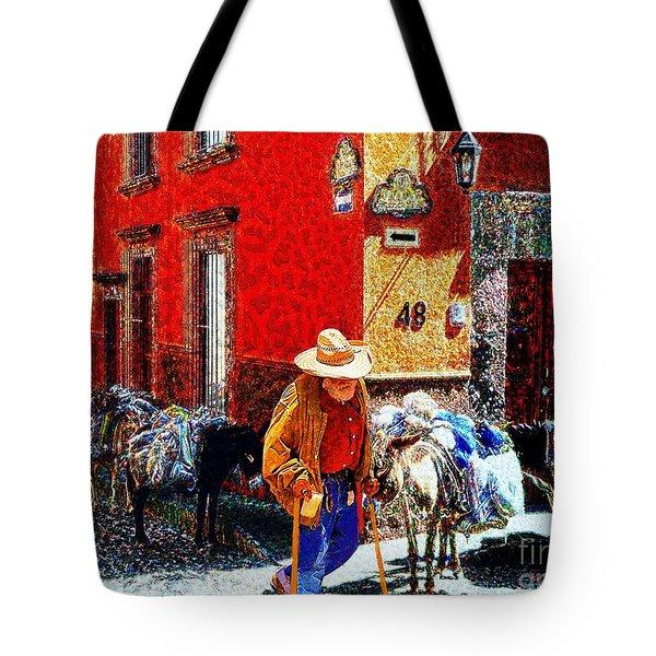 Old Timer With His Burros On Umaran Street Tote Bag by John  Kolenberg