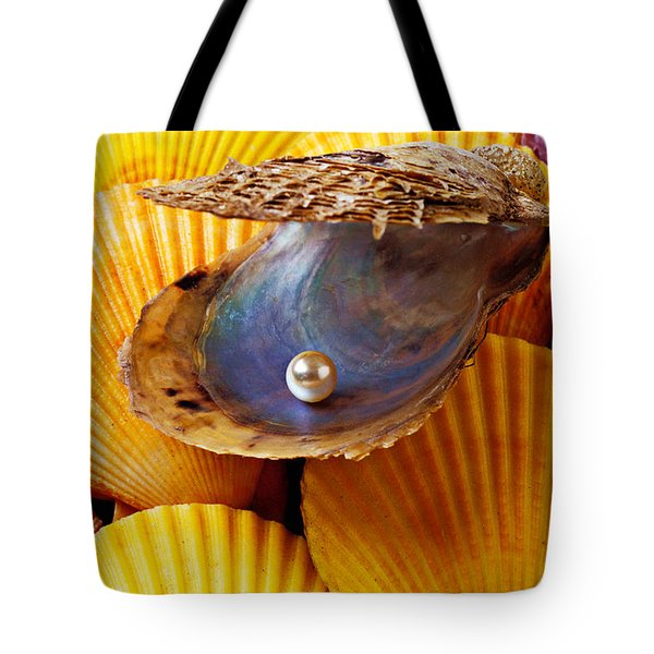 Pearl in oyster shell Tote Bag by Garry Gay