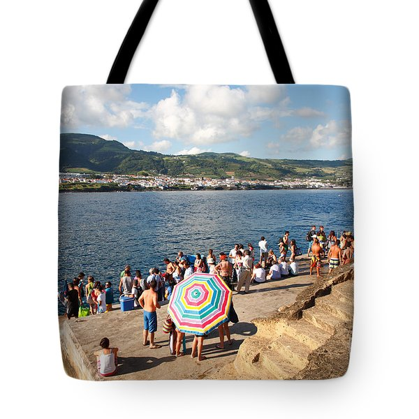 People Waiting At The Islet Tote Bag by Gaspar Avila