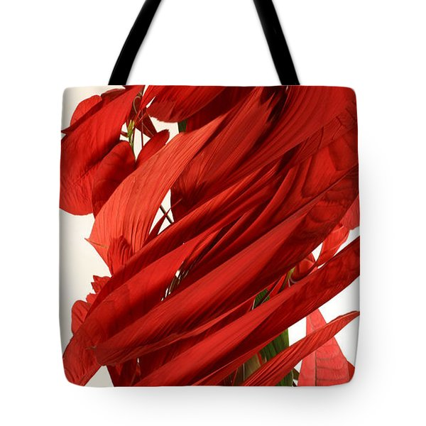 Peripheral Streak Image Of A Poinsettia Tote Bag by Ted Kinsman