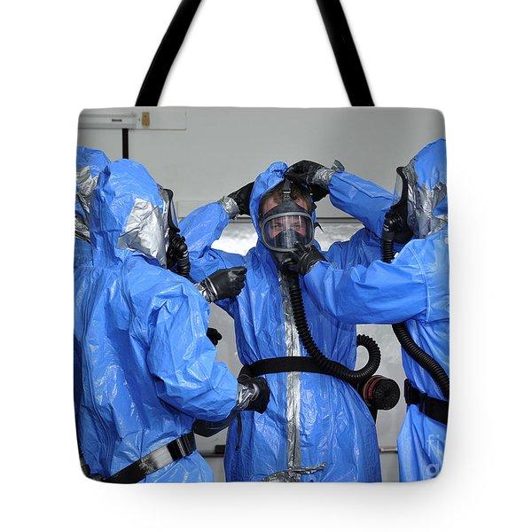 Personnel Dressed In Hazmat Suits Tote Bag by Stocktrek Images