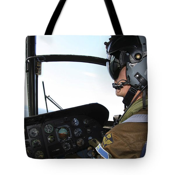 Pilot In The Cockpit Of A Ch-46 Sea Tote Bag by Daniel Karlsson