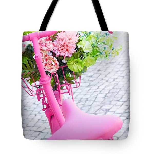 pink bicycle Tote Bag by Carlos Caetano