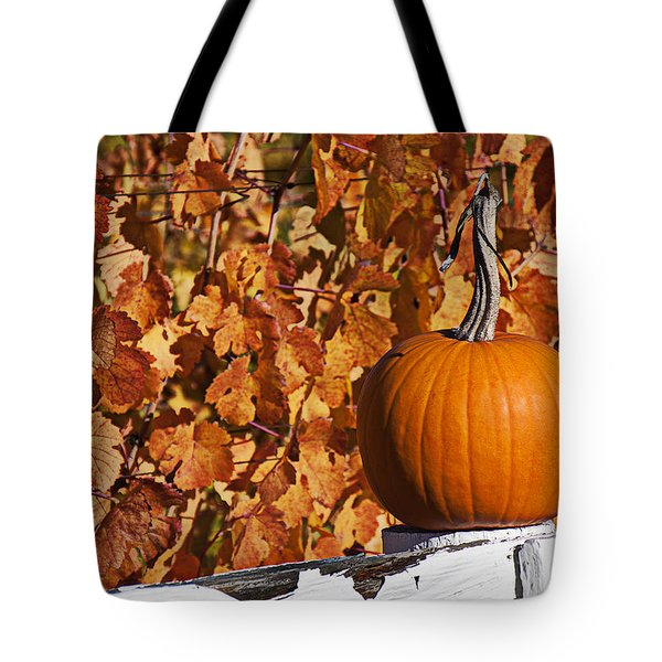 Pumpkin on white fence post Tote Bag by Garry Gay