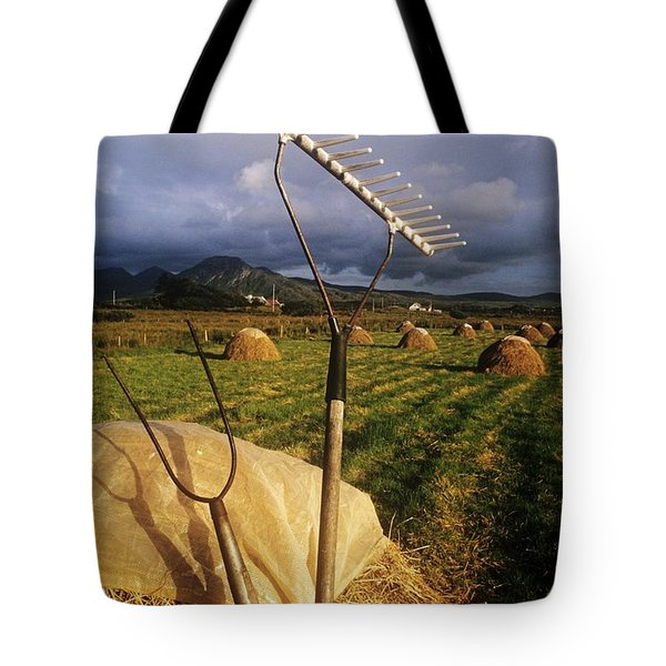 Rake With A Pitchfork On Hay In A Tote Bag by The Irish Image Collection