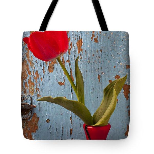 Red Tulip Bending Tote Bag by Garry Gay