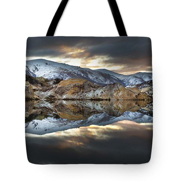 Reflections Of Cliffs On Blue Lake St Bathans Tote Bag by Colin Monteath