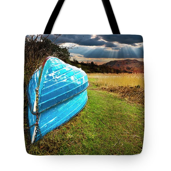 row boats in waiting Tote Bag by Meirion Matthias
