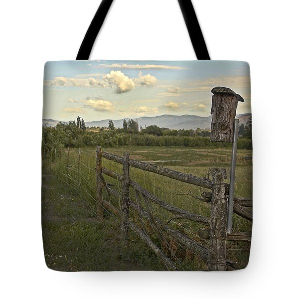 Rural Birdhouse On Fence Tote Bag by Mick Anderson