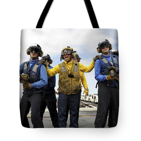 Sailors Fight A Simulated Fire Aboard Tote Bag by Stocktrek Images