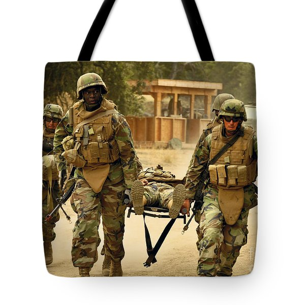 Seabees Conduct A Mass Casualty Drill Tote Bag by Stocktrek Images