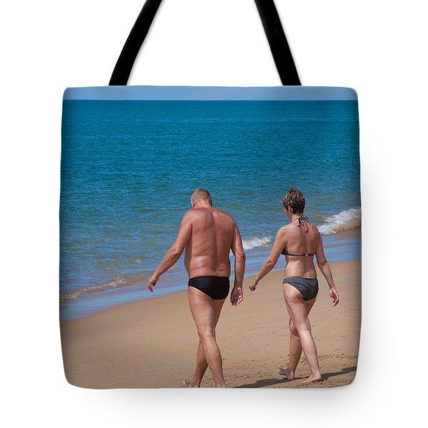 senior elderly  lover couple Tote Bag by ATIKETTA SANGASAENG