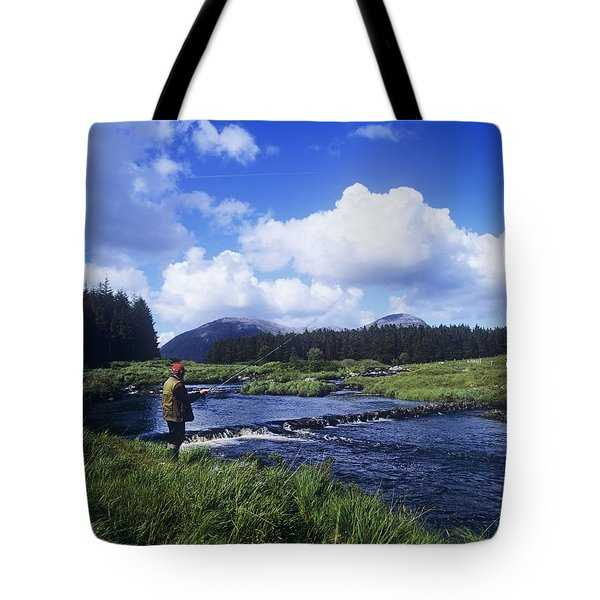 Side Profile Of A Man Fly-fishing In A Tote Bag by The Irish Image Collection
