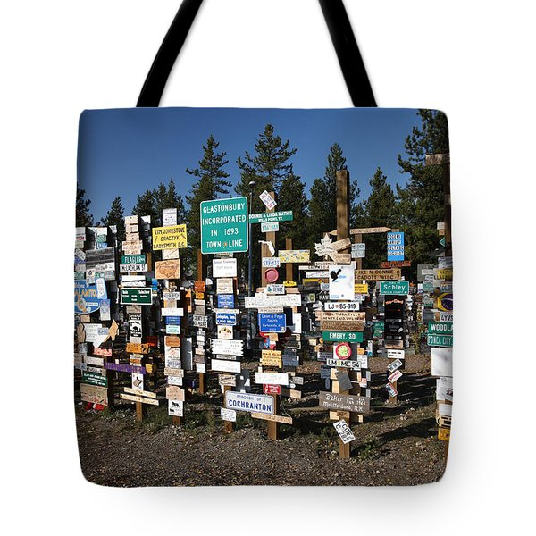 Sign posts forest in Watson Lake Yukon Tote Bag by Mark Duffy