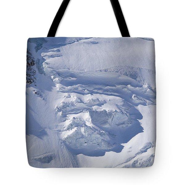 Skiers Cross The Aletsch Glacier En Tote Bag by Axiom Photographic